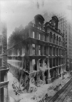 Ruins of Equitable Life Assurance Society building in New York City, Jan 11, 1912, by Irving Underhill.  The building, originally at Broadway & Cedar St. in NYC burned, leaving nothing but the facade, covered in ice from the firetrucks.