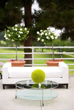 Outside the box flower centerpiece- i love the couch for the lounge area!