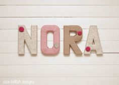 Wrap plain wooden letters in yarn and decorate with flowers ribbon etc easy and cheap home decor