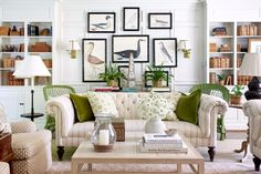 Green Hills Georgian - Sarah Bartholomew - fabulous neural toned living room with beautiful built-in book-cases and millwork and wonderful art wall - Chesterfield sofa -