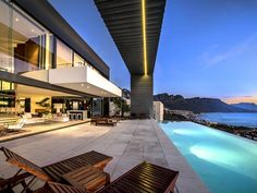 A fabulous Waterfront Fashionable Mansion in South Africa.  It measures a total of 18,104 square feet, with 5 bedrooms, 5 bathrooms, 2 living rooms, 2 gourmet kitchens, a staircase, an elevator, a family room, a laundry room, a home theater and a 4-car garage.  The exterior has a Zen garden and an infinity edge swimming pool.