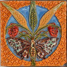 ". . Tile ""Butterfly and ears of corn"" designed by Rafael Bordalo Pinheir (1846-1905) and manufactured by Fábrica de Faianças das Caldas da Rainha c. 1905 Portugal. Found at the Museu Nacional do Azulejo in Lisbon. . . by philatile"