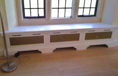 Window seat radiator cover. I like this but with a different grate.
