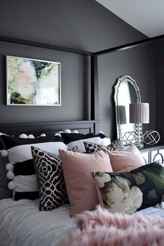 I love the color on the wall and the beautiful pillows.