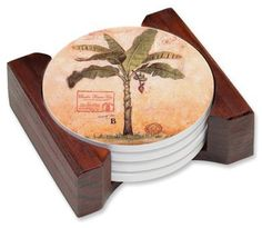 """Palm Tree Ceramic Drink Coaster Set by Art Plates. $29.75. 5-piece coaster set has four beautifully decorated porcelain coasters with a wood holder.. Each coaster has a protective cork bottom.. FREE SHIPPING!. Images are durable and permanent.. Set Measures: 4.5"""" W x 4.25"""" L x 1.75"""" H. If you are looking for something to WOW your guests, here it is. This 5 piece ceramic coaster set will make your event memorable each and every time your guests see it. Beautiful..."""