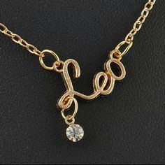 """Leo zodiac necklace Zodiac signs necklace gold tone This listing is for """"LEO"""" see other listings for the other signs New in plastic packaging Length 16.5 inches ** Jewelry Necklaces"""
