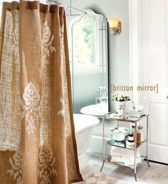 Love the curtain and claw foot tub!