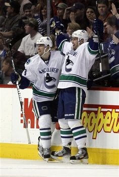 Chris Higgins and Christoper Tanev on 3/24/2012 celebrate their W