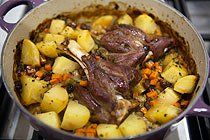 Braised Lamb Shanks ~ Lamb shanks braised with onions, garlic, carrots, celery, potatoes, raisins and mint, and seasoned with oregano, thyme, and rosemary. ~ SimplyRecipes.com