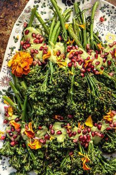 Roasted Broccolini with Herb Tahini Sauce - Heather Christo Side Recipes, Healthy Recipes, Roasted Broccolini, Gluten Free Thanksgiving, Tahini Sauce, Glaze Recipe, Pomegranate Seeds, Oven Roast, Veggie Dishes