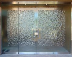 Stone Frameless Glass Doors by Sans Soucie create privacy thru art! Stunning designs in any decor! Huge archive of designs or a new custom design to your specs!