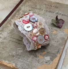 Beautiful handcrafted cuff made from antique lace, vintage buttons and lots of tiny glass beads. Would also make a lovely bridal accessory. ****...
