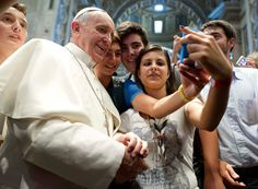 Pope Francis poses for a 'selfie' at the Vatican