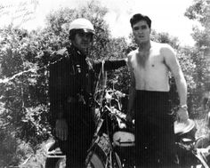 It seems every policeman in the U.S.A want a photo taken with Elvis. This policeman was on the set of 'Kid Galahad' when he met a shirtless Elvis