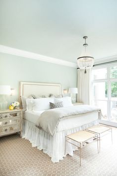 There is nothing more soothing than a bedroom draped in white and sea foam green. | Inside Spaces
