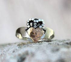 We love this fresh take on the traditional Claddagh ring, with its textured surface and mix of silver and gold. #etsyjewelry