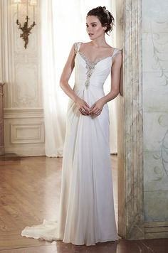 This chiffon sheath wedding dress is sweetened with crystals trailing the neckline and scalloped back. Maggie Sottero, Spring 2015