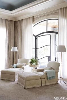 Armchairs and ottomans in a Larsen fabric; floor lamps, Dessin Fournir; table, Rose Tarlow Melrose House; curtains in a Fortuny fabric; carpet, Scott Group.   - Veranda.com