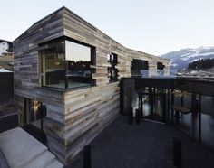 Love the rustic wood cladding that sometimes intrudes on the glazed areas. Kitzbuehel Mansion