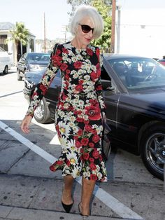 Helen Mirren wears a floral Dolce & Gabbana midi dress with cat-eye sunglasses and and pointed-toe
