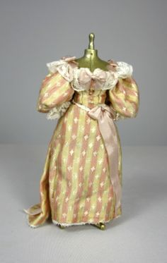 Pink and cream striped silk dress on gold mannequin. Handcrafted