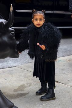THIS IS BORDERLINE CHILD ABUSE~ DRESSING A GORGEOUS LITTLE GIRL IN THIS CRAP! SHE LOOKS HUNCHED-BACK AND LIKE SHE HAS SPECIAL SHOES ON. WOW!