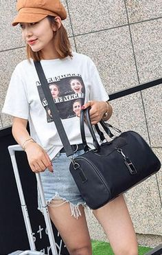 Casual Stylish Woman With Black Modern Classic Duffel Handbag - Front View Fashion Bags, Womens Fashion, Modern Classic, Leather Bag, Duffel Bags, Street Style, Woman, Stylish, Casual
