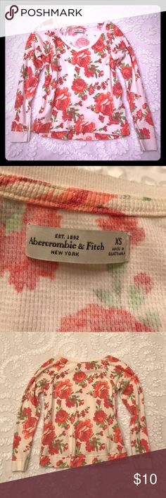 Abercrombie Floral crop shirt Cute Abercrombie top!  Well loved!  No flaws!  Great for a spring or summer night at the fire!  Definitely a good pair for your favorite jeans!! Abercrombie & Fitch Tops Crop Tops
