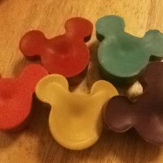 Mickey Mouse crayons made by melting down old crayons and molding them with a Mickey ice cube tray.  A great gift for kids.