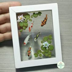 This is the other miniature koi pond in a frame I made for SuperCon last weekend. The koi fish and plants were hand sculpted from polymer clay. The water is a clear resin. The frame is a small wood. 3d Resin Painting, Diy Resin Art, Diy Resin Crafts, Picture Frame Crafts, Picture Frames, Arte Do Kawaii, Resin Furniture, Small Wood Projects, D House