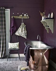Looking for bathroom decorating ideas? Check out this purple bathroom with copper bath
