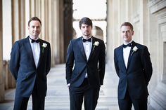 Black tuxedos. Groom has black buttons and groomsman do not.