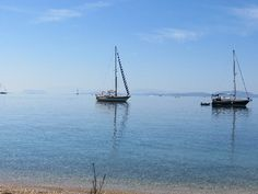 Greece, Ionian Sea, Yachts anchor off in Paleros bay.