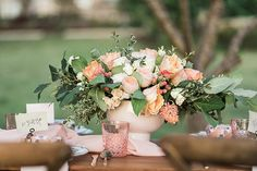 pink and peach wedding florals - photo by B. Jones Photography http://ruffledblog.com/wallpaper-and-watercolor-wedding-ideas