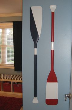 Painted oars from Academy Sporting Goods. The reverse side is painted white and was used as the sign in for guests at the baby shower. Oar Decor, Coastal Decor, Diy Room Decor, Nautical Bedroom, Nautical Home, Painted Oars, Painted Furniture, Cottage Living, Beach House Decor