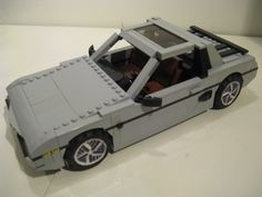 https://flic.kr/p/qq46Hs | 1985 Pontiac Fiero | Here are some color shots. Played around with the front a bit.   Built for the LUGNuts 85th Build Challenge…Like, Totally 80's!, this is my rendition of the 1985 Pontiac Fiero.      Not many cars from the 80s left their mark on me, maybe Magnum P.I.s Ferrari or the A-Team van, but I remember being really impressed by my neighbors Fiero, even though if memory serves me right, they were lemons.