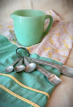 '40's apron, jadite pitcher, measuring spoons