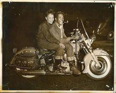 circa 1950s– Black couple motorcycling