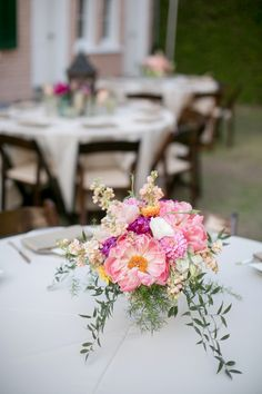 Gorgeous pink centerpiece | A Pink Vintage Chic North Carolina Wedding via TheELD.com