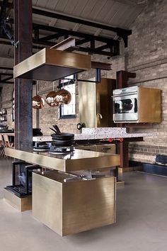 I love the use of steel I-beams in this kitchen design.