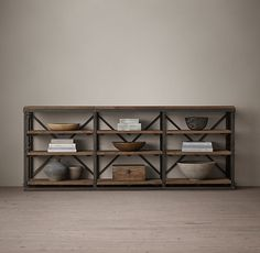 "RH's French Library 90"" Console:A reproduction of a mid-1940s eastern European library bookcase, our console is heir apparent to the imperfect beauty of an antique. Crafted from iron and hardwood, it displays books and other collectibles."