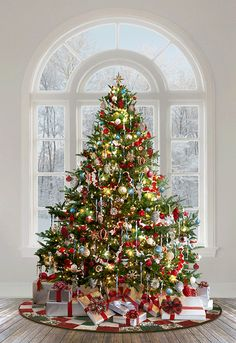 Ol St Nick Collection Christmas Tree In Front Of Window Happy New Year Silver Christmas Decorations, Christmas Tree Themes, Noel Christmas, Rustic Christmas, Christmas Traditions, Christmas Ornaments, Holiday Decor, Traditional Christmas Tree, Decorated Christmas Trees