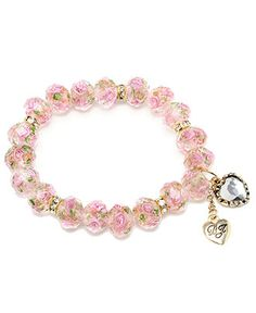 Floral and fanciful. With its beautiful pink blooms, Betsey Johnson's beaded stretch bracelet lends a touch of springtime to your look all year long.