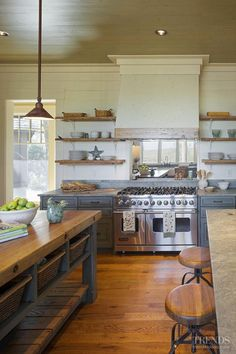 Rustic Kitchen Hood. Rustic Kitchen Hood Design. John Zook from Wood Creations, Inc., built the gorgeous cabinets and the rustic-looking open shelves. They add so much to this kitchen. Range is Viking. Picture via Kitchen TRENDS. Interiors by Gregory Vaughan, Kelley Designs, Inc. Photos by Atlantic Archives, Inc.