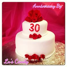 Anniversary cake inspired inthe original wedding colors and flower (red roses) detailed with pearls representing 30 years