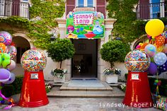Look at the giant gumball machines and the party welcome sign at this candyland birthday party! #candyland #birthday #party #ideas #giant #gumball #machine #sign
