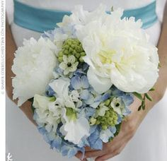 The Bridesmaid Bouquet    The bridesmaids carried clusters of lush white peonies, soft blue hydrangeas, and touches of greenery.