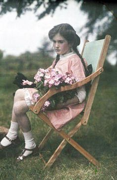 Autochromes taken between 1910 and 1915. They show Janet or Iris Laing in their parents' house and garden in Headington, Oxford.