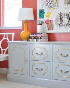White hollywood regency living room white sideboard salmon pink walls