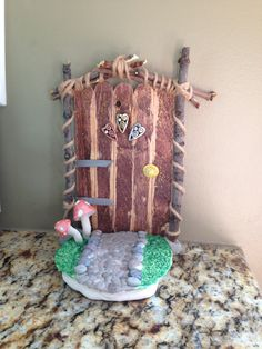 Fairy door for your garden. Polymer clay, paint, sticks, twine, Popsicle sticks and done!